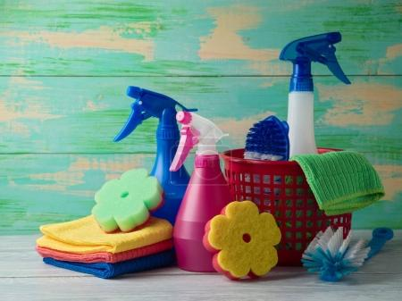Photo for Spring cleaning concept with supplies on wooden table - Royalty Free Image