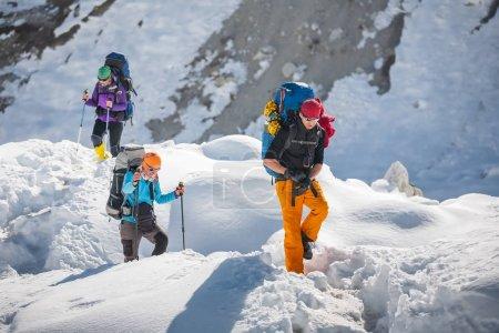 Trekkers crossing Gokyo glacier in Khumbu valley on a way to Eve