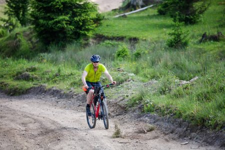 man rides the bicycle up in the mountains