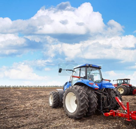Agricultural machinery cultivates the field