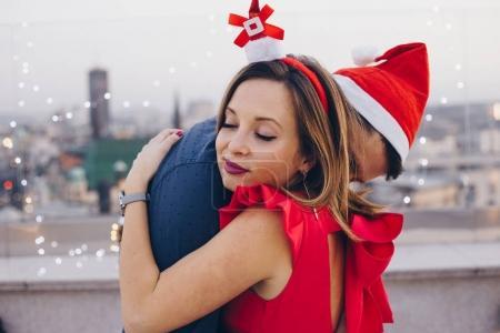 Loving couple on roof
