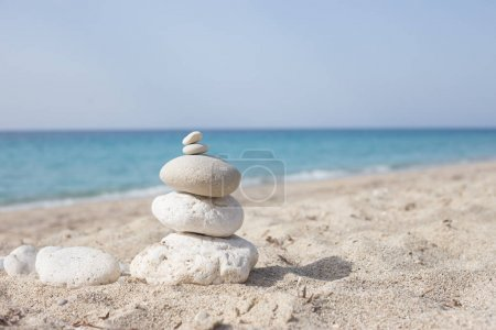 White stones on beach sand. Concept of balance and wellness.