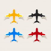 Four colorful signs of planes isolated on white background