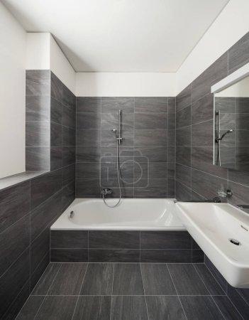 Interior of a modern house, gray bathroom