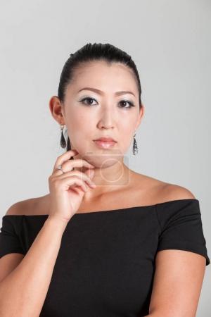 Elegant Asian woman in studio, portrait