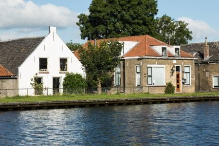 Dutch typical houses by the river bank