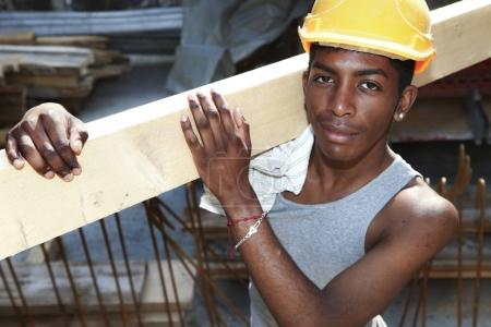 young african man working in construction site