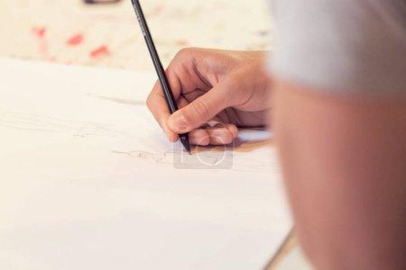 Female hand drawn, student
