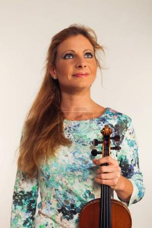 Young blond woman posing in studio