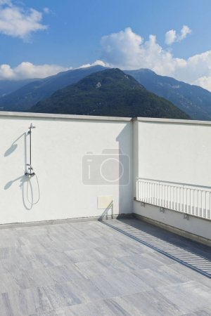 Photo for Large terrace of a modern white house, shower - Royalty Free Image