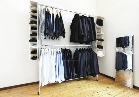 Photo for Wardrobe in a lighting room with a mirror - Royalty Free Image