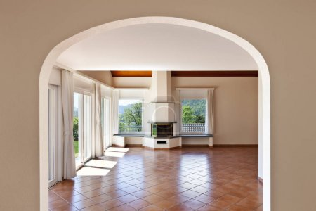 Photo for Home, arched window, view of room with fireplace - Royalty Free Image