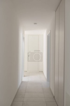 Photo for White empty corridor with many closets. Nobody inside - Royalty Free Image
