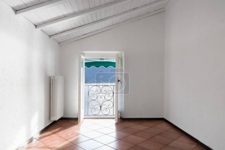 White room with lake view. Nobody inside