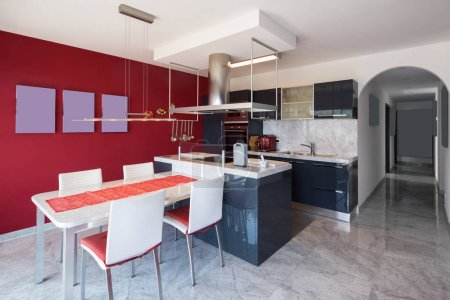 Modern kitchen with island, marble table and leather chairs