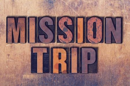 Mission Trip Theme Letterpress Word on Wood Background
