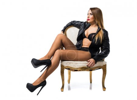 Sexy woman in lingerie in a vintage armchair