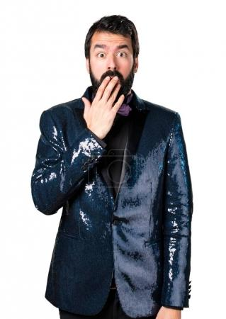 Handsome man with sequin jacket making surprise gesture