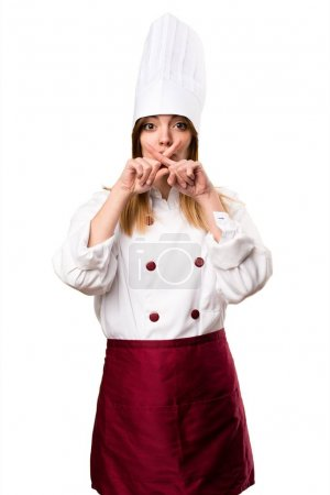 Beautiful chef woman making silence gesture