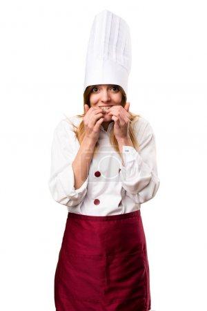 Frightened beautiful chef woman