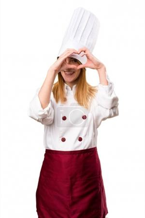 Beautiful chef woman making a heart with her hands