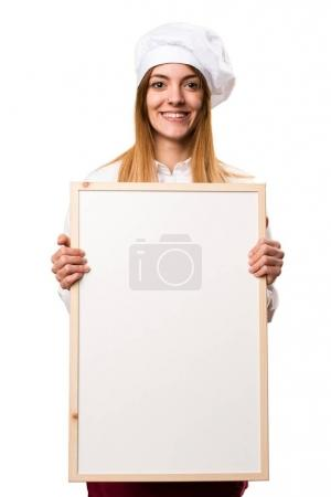 Happy Beautiful chef woman holding an empty placard