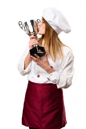 Beautiful chef woman holding a trophy