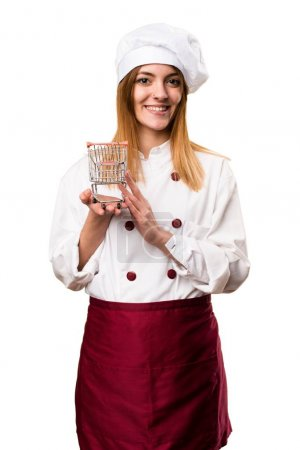 Happy Beautiful chef woman holding a supermarket cart toy