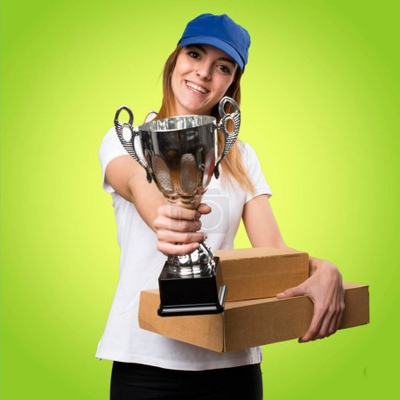 Delivery woman holding a trophy on colorful background