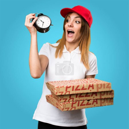 Pizza delivery woman holding vintage clock on colorful backgroun