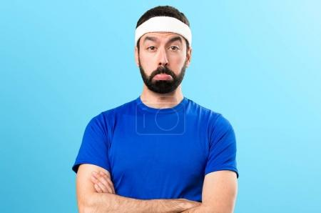 Sad funny sportsman on colorful background