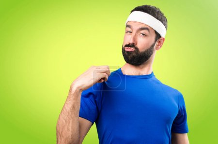 Funny sportsman proud of himself on colorful background