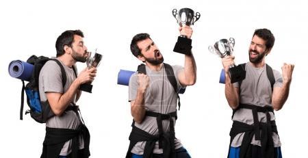 Set of Handsome backpacker holding a trophy