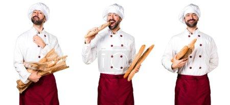 Photo pour Jeune boulanger tenant du pain - image libre de droit