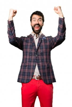 Lucky well dressed man on white background