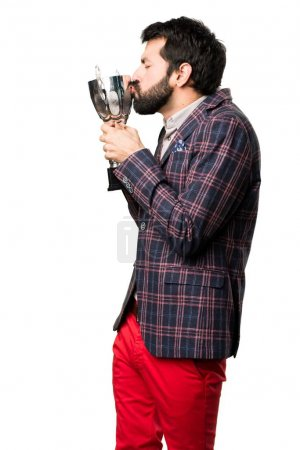 Photo for Happy Well dressed man holding a trophy on white background - Royalty Free Image