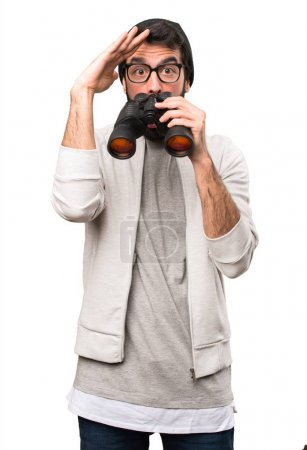 Hipster man with binoculars on white background