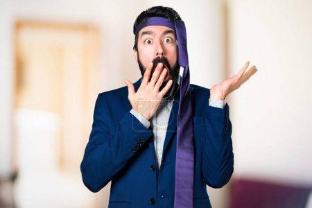 Crazy and drunk businessman making surprise gesture on unfocused