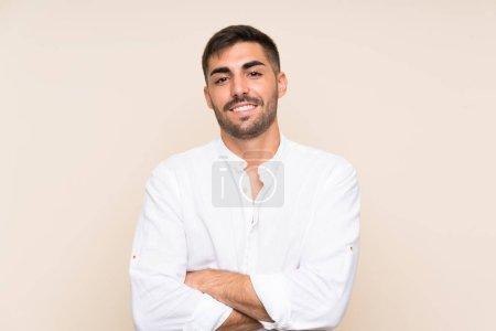 Photo pour Beau homme avec barbe sur fond isolé riant - image libre de droit