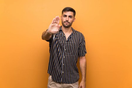 Photo for Handsome man with beard over isolated background making stop gesture - Royalty Free Image