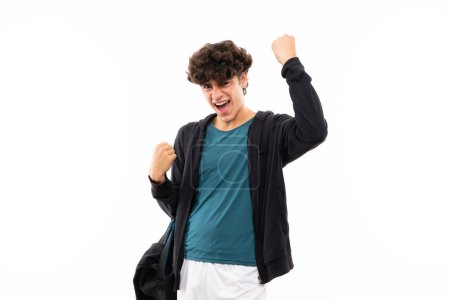 Photo for Sport man over isolated white background celebrating a victory - Royalty Free Image