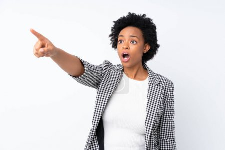 Photo pour African american woman with blazer over isolated white background pointing away - image libre de droit