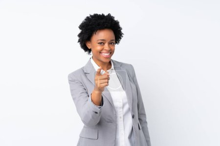 African american business woman over isolated white background points finger at you