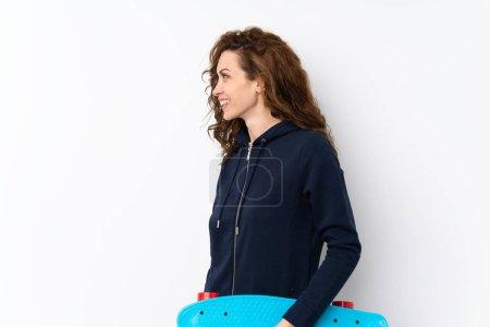 Photo pour Jeune jolie femme sur fond isolé avec patins - image libre de droit