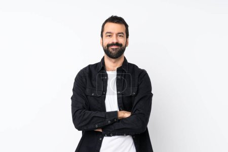 Photo for Young man with beard over isolated white background keeping the arms crossed in frontal position - Royalty Free Image