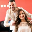 Smiling hairsyilist and his satisfied client at be...