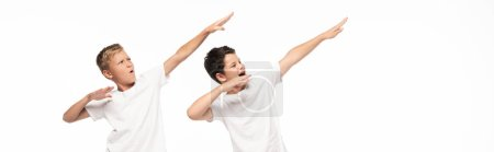 Photo for Panoramic shot of two brothers imitating archery isolated on white - Royalty Free Image