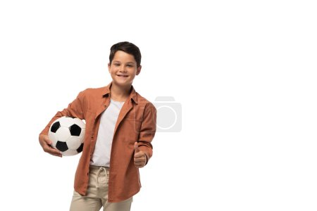 Photo for Cheerful boy holding soccer ball and showing thumb up isolated on white - Royalty Free Image