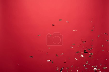 Photo for View of golden confetti isolated on red with copy space - Royalty Free Image
