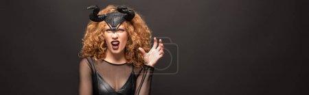 Photo pour Costume d'halloween avec des cornes sur fond noir - image libre de droit